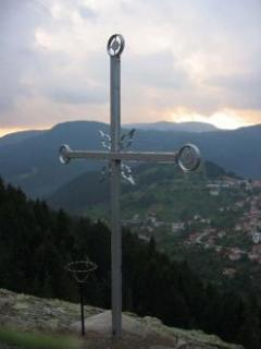 A cross on a cliff impresses visitors of the village Momchilovtsi